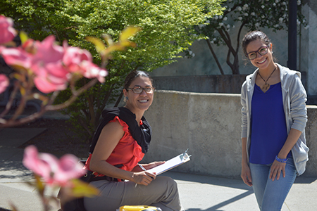 Two women on campus in spring