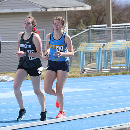 Lady sasquatch running distance race on the track