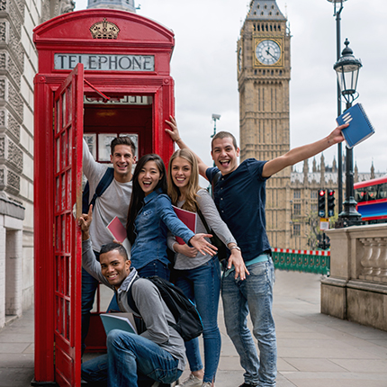 Students in London posing in a phone booth
