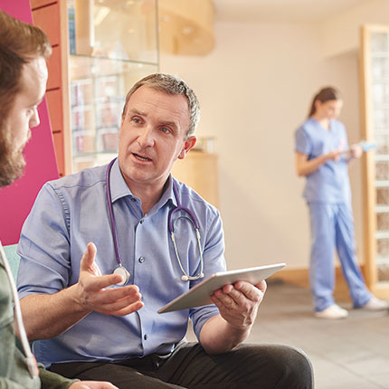 a Nurse Practitioner talking to a person