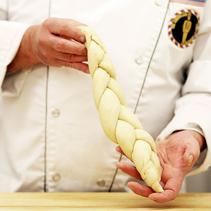 Chef holding braided dough