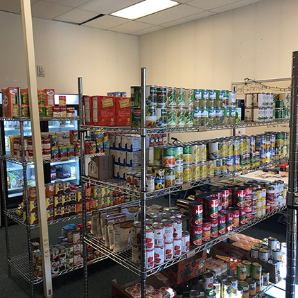 SFCC Food Pantry showing stacks of canned goods