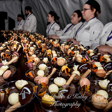 Inland Northwest Culinary Academy students standing behind a buffet of desert dishes