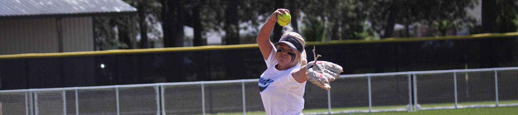 Softball player pitching windup