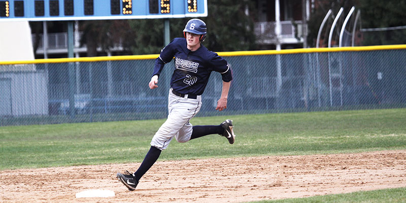 Baseball player running to the base