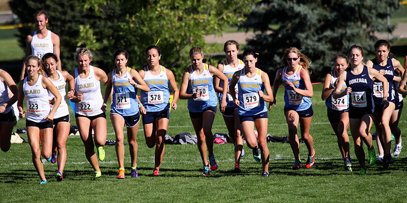 The Bigfoot Women's Cross COuntry team at the starting line of a meet against Idaho