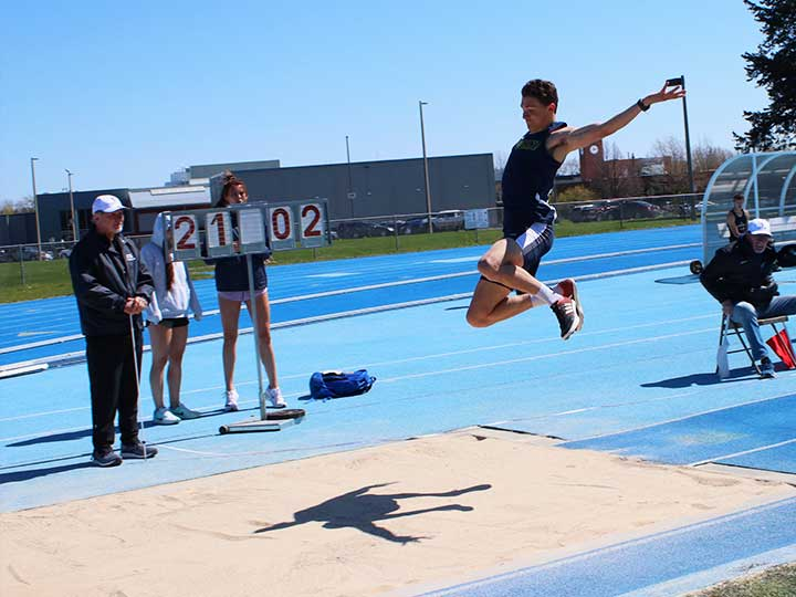 Men's track and field long jump midair
