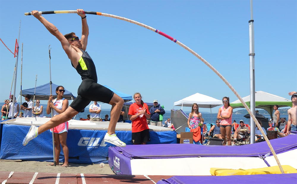 Pole vaulter in mid air