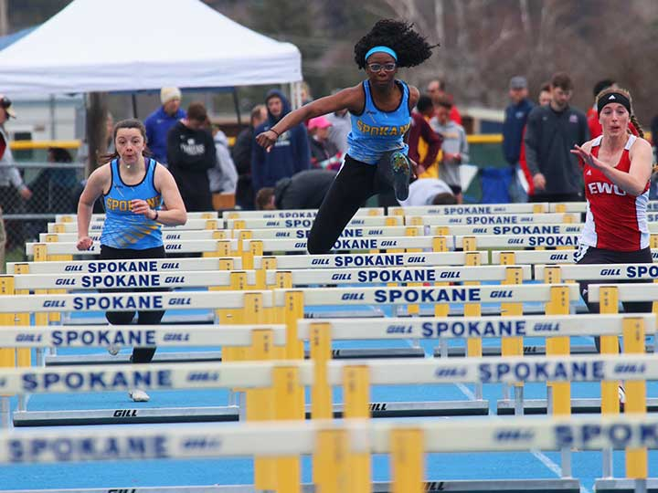 Women' stack and field hurdles in the air